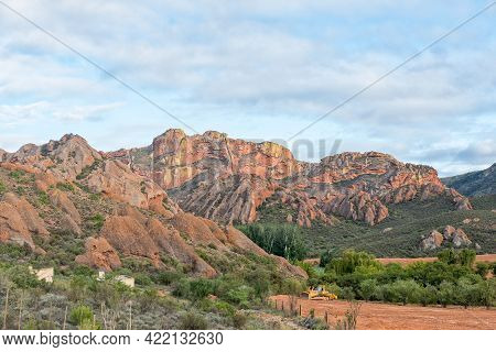 Red Stone Hills, South Africa - April 6, 2021: A Farm And Mountain Landscape At Red Stone Hills In T