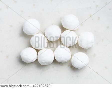 Several Raw Tapioca Pearls Close Up On Gray Ceramic Plate