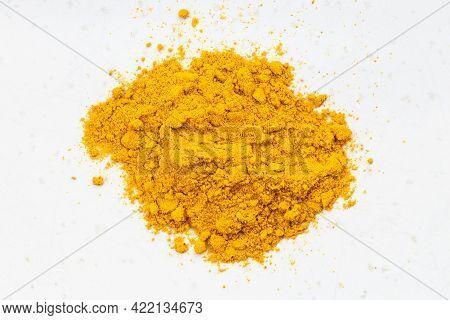 Top View Of Pile Of Turmeric (curcuma) Powder Close Up On Gray Ceramic Plate