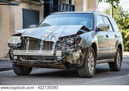 Crashed Car In Car Accident. Broken Vehicle After Fatal Disaster. Road Collision Damage. Gray Car Ge