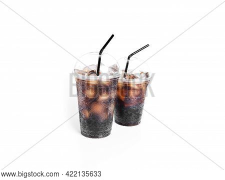 Soda With Ice In A Transparent Plastic Glasses Isolated On A White Background.