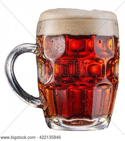 Mug of malt red beer a large head of beer foam isolated on white background. File contains clipping path.
