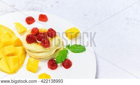 Homemade Pancake With Honey And Raspberry. Dessert With Sweet Mango.