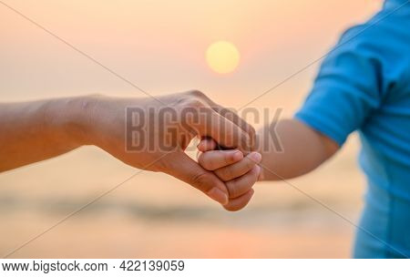 Mom And Kid Togetherness With Sunset At The Beach On Summer Holiday.