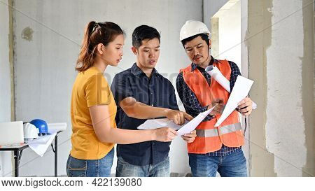Owner Of New House Inspection With Engineer And Architect. Love Couple At Village Project And Estate
