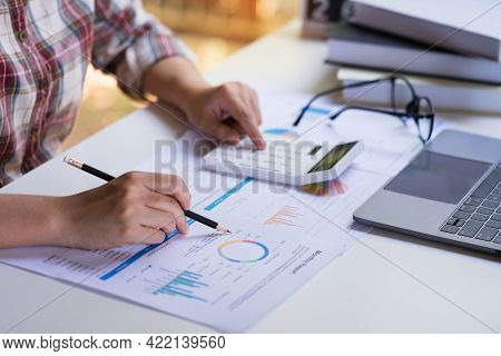 Businesswoman Or Professional Entrepreneurs Pointing The Profit Chart, Company Income And Using Calc