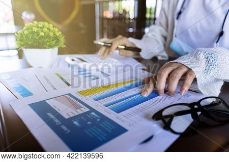 Close Up Businesswoman Hand Using Calculator And Pointing Document About Monthly Expenses, Managing