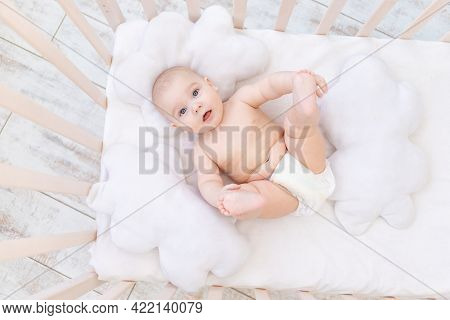 Baby Boy In The Crib In The Nursery, Cute Funny Little Baby Six Months, Healthy Sleep Concept