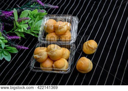 Homemade Cream Puffs Or Eclaire Filled With Vanilla Custard Cream On Cooling Rack. Golden Choux Crea