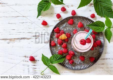 Summer Cool Milkshake. Raspberry Protein Shake In Glass And Fresh Raspberry On A Wooden Table. Top V
