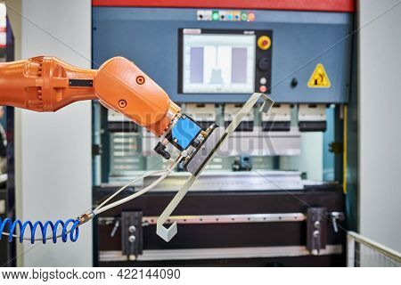 Robot load-unload system for cnc hydraulic sheet bending machine. Automation and robotics in industry