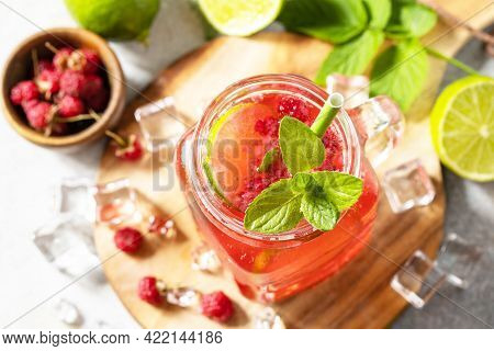 Soft Drinks, Healthy Beverage. Refreshing Summer Glasses Drink Raspberry With Mint Lime And Ice On A