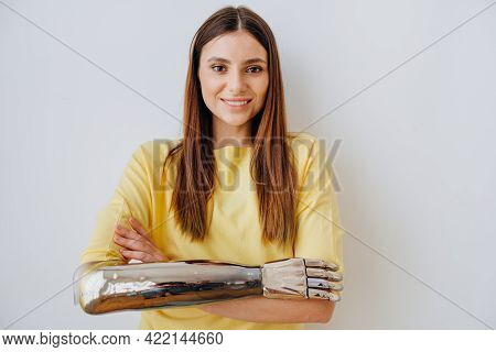 Smiling Woman With Elegant Bionic Prosthesis Arm On Grey