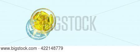 Omega3 Gel Capsule. Sun Shadow. Yellow Vitamin. Health Eating. Dietology Drug. Fish Oil Supplement.