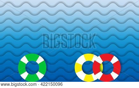 Lifebuoys In Sea Waves. Top View. Color Lifebuoys And Blue Ocean Background