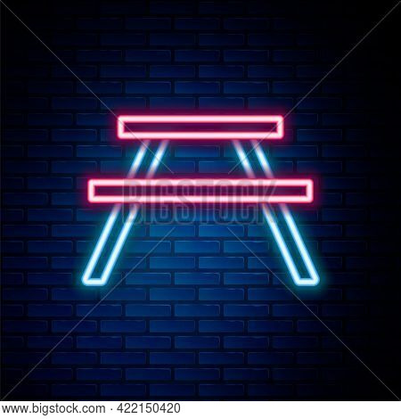 Glowing Neon Line Picnic Table With Benches On Either Side Of The Table Icon Isolated On Brick Wall