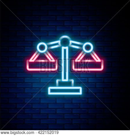 Glowing Neon Line Scales Of Justice Icon Isolated On Brick Wall Background. Court Of Law Symbol. Bal