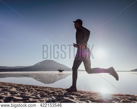 Full Length Of Healthy Man Running And Sprinting Outdoors. Male Runner. Man Running On The Beach At