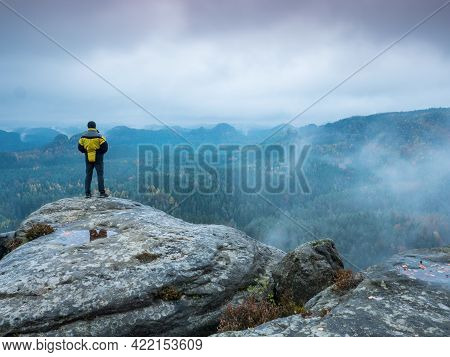 Man Tourist  Looking Over Mountain Valley With Sunbeams At Colorful Autumn Mist In Europe. Landscape