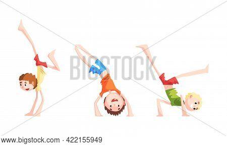Cute Boys Practicing Martial Arts Set, Kid Standing Upside Down Cartoon Vector Illustration