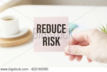 Reduce Risk Text On The Card In Hand Woman.