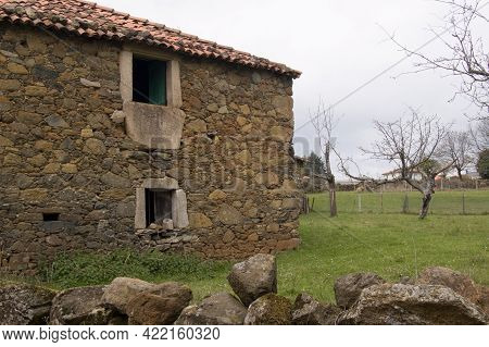 Ancient Rural House In Galicia, Made Of Stones And Wood. Spain, Europe