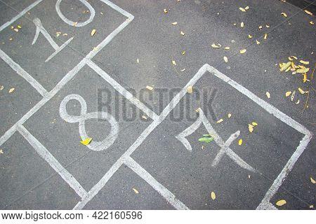 Close-up Hopscotch Kid Game Drawn On Pavement