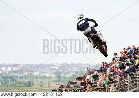A Lone Motorcycle Racer In The Air In Front Of The Grandstand. Selective Focus.