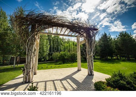 Pergola In A Garden With Fresh Lawn Around. Patio Place