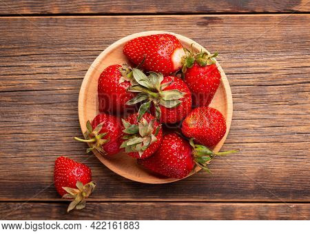Ripe Strawberries In A Plate Close-up. Strawberries Top View. Strawberry Harvest.