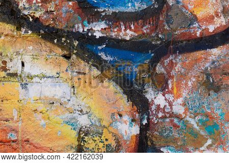 Graffiti Brick Wall, Colorful Background. Texture Of A Brick Wall Painted With Color.