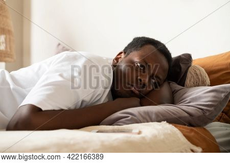 Lonely African Man In Bed With Mobile Smartphone Waiting For Call