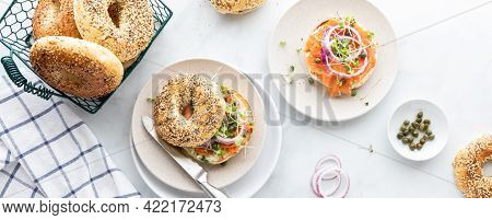 Narrow View Of Everything Bagels With Cream Cheese, Smoked Salmon Lox And Garnished With Capers And