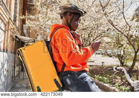 Man Courier Using A Map App On Mobile Phone To Find The Delivery Address