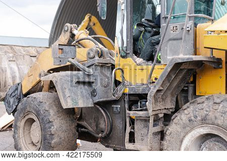 Large Bulldozer Rear And Left. Dirty Yellow Bulldozer Close-up With Open Cab.