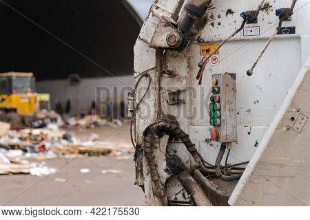 Garbage Truck Press Control Buttons. The Back Of A Garbage Truck On The Background Of A Garbage Sort