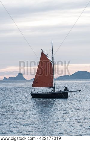 Sailing Boat On The Island Of Formentera In The Summer Of 2021 With Es Vedra Behind.