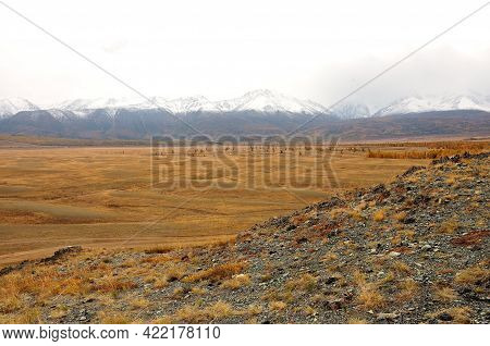 View From The Top Of The Mountain To The Desert Desert Steppe At The Foot Of The Mountain Range.
