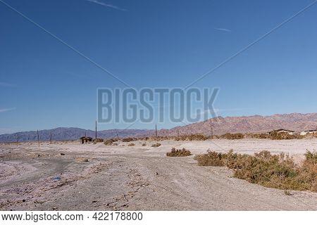 Usa, Ca, Salton Sea - December 28, 2012: White-gray Salty Sand Of Se Shoreline Near Niland Marina Wi
