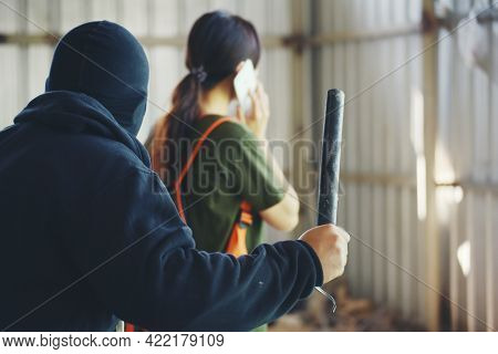 Thief Armed Man Rob Woman By Baton On Street Stalker Behind Young Woman Back. Woman On Phone Careles