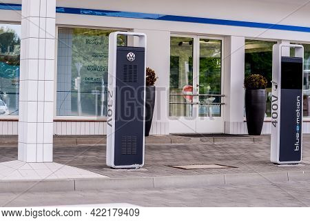 Wolfsburg, Germany - June 19, 2016: Volkswagen Electric Charging Station Charge Cable An Electric Ve