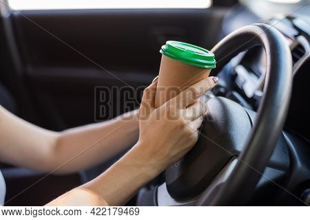 A Faceless Woman Is Drinking Coffee In A Craft Glass While Driving. Take A Hot Tonic Drink To Take A