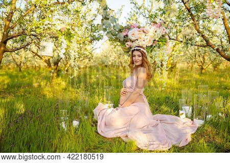 Beautiful Soft And Sensual Pregnant Girl. Spring Mood, Beautiful Pregnant Woman, Smell Flowering Che