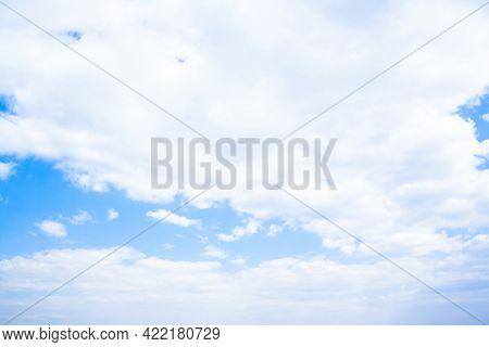 Huge Clouds In Blue Sky Lit By The Sun, Not Windy.