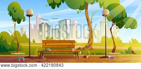 Dirty City Park With Green Trees And Grass, Wooden Bench, Lanterns And Town Buildings On Skyline. Ve