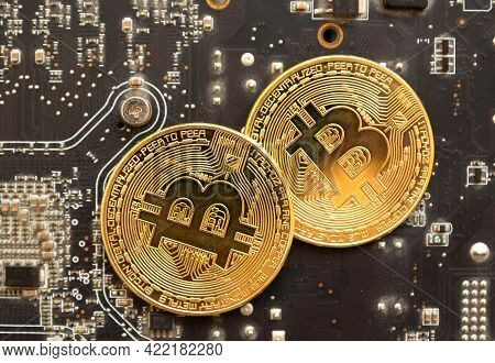 Close Up Of Bitcoins On The Motherboard Of A Computer Video Card. Cryptocurrency And Motherboard. Cr