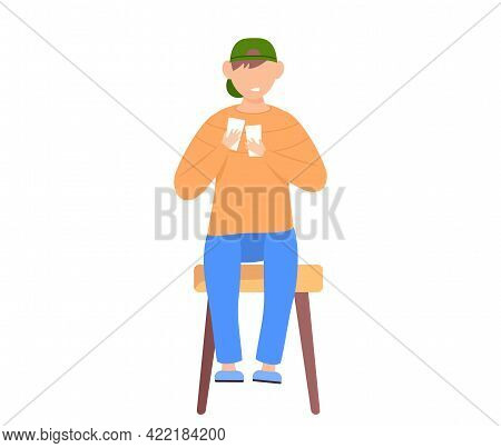 Boy Teenager Sitting On Chair And Holding Piece Of Paper. Kid Dressed In Casual Clothes Examines Car