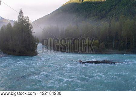 Foggy Turquoise Kucherla Mountain Glacier River In The Forest. Belukha Park, Altai Republic, Siberia