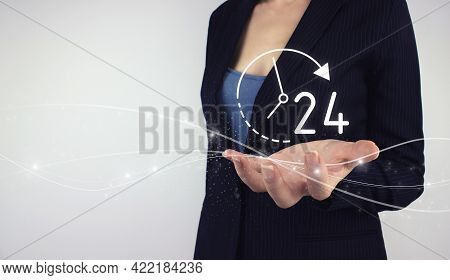 Full Time Service Concept. Hand Hold Digital Hologram 24 All Day All Night Icon On Grey Background.