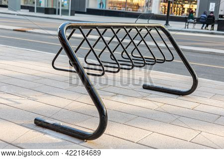 Empty Bike Rack For Parking Bicycles In The Street.